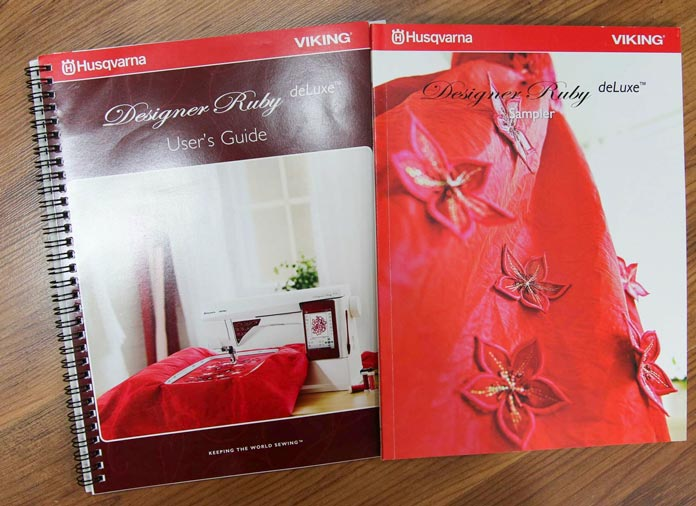 The User's Guide and the Sample book of the built-in embroidery motifs on the Husqvarna Viking Designer Ruby deLuxe