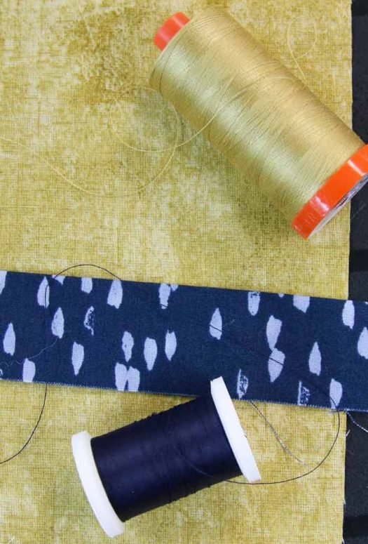 Matching threads for the backing (yellow) and the binding (blue)