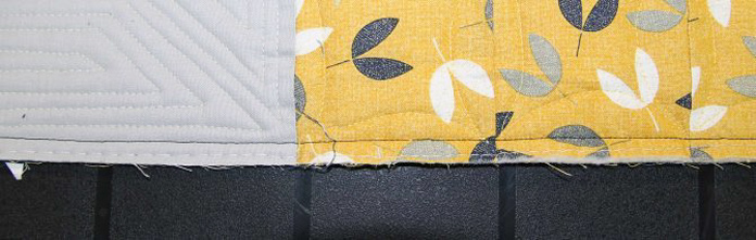 Even, smooth seam from stitching the binding to the back of the quilt.