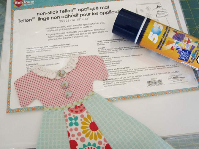 Spray the back of the dress on the applique mat.