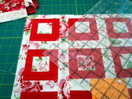 Use a 12.5 inch square ruler to trim up the blocks to a uniform size.
