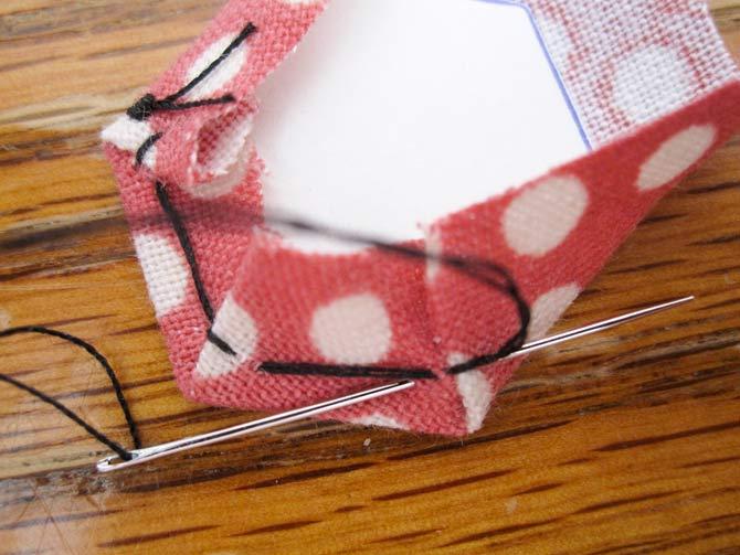 Basting technique to wrap fabric around EPP templates.
