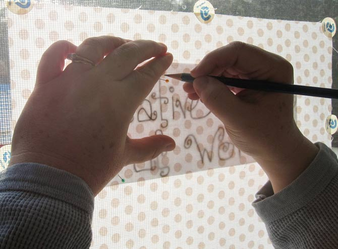 The low tech, but highly effective, method of transferring words to the main fabric.