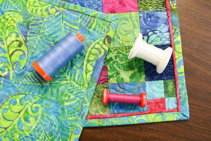Threads used to attach the piping and binding to the table runner