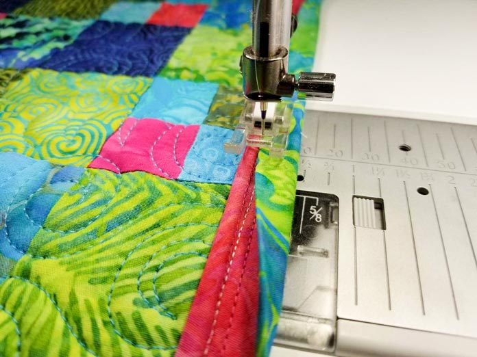 Stitching the binding to the front of the table runner