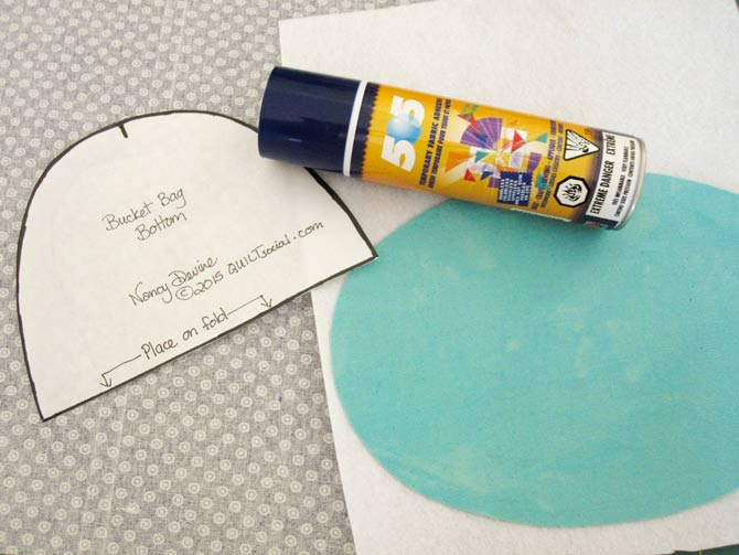 Spray baste the heavy weight interfacing and the canvas bag bottom together.
