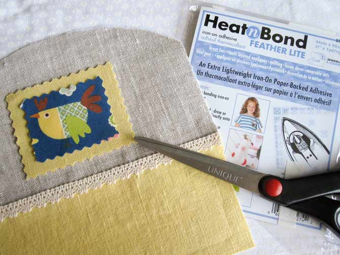 HeatnBond Featherlite iron on adhesive helps anchor the mug cozy embellishment so you can add some hand stitched details.