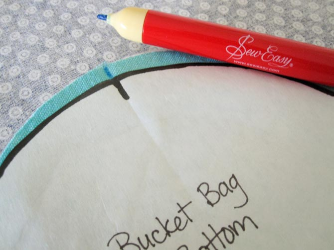 Mark the mid point of the bag bottom on both sides of the fabric when you trace the template provided on the canvas bag bottom.