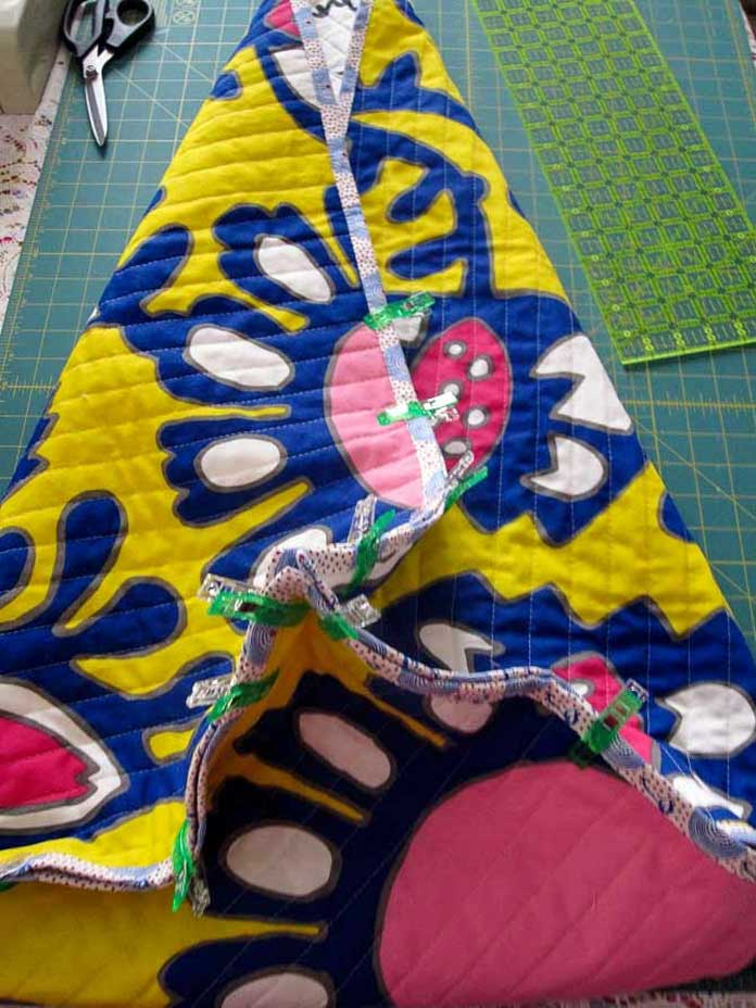 Folded, clipped and ready to be stitched up. This big storage bag is taking shape.