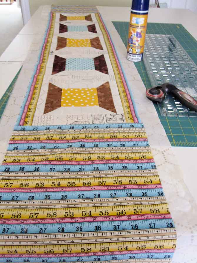 Baste the layers of the quilt sandwich together using 505 Adhesive.
