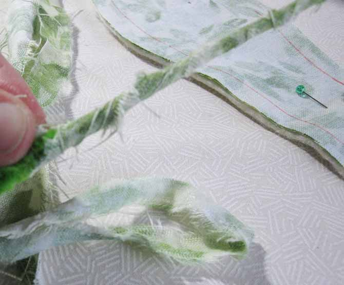 Wrap pipe cleaner stems in thin strips of fabric.