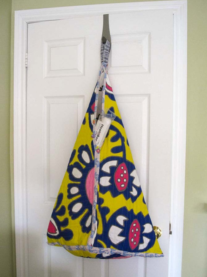 Look, up on the door hook! It's a bag. It's a quilt! It's quilted storage!