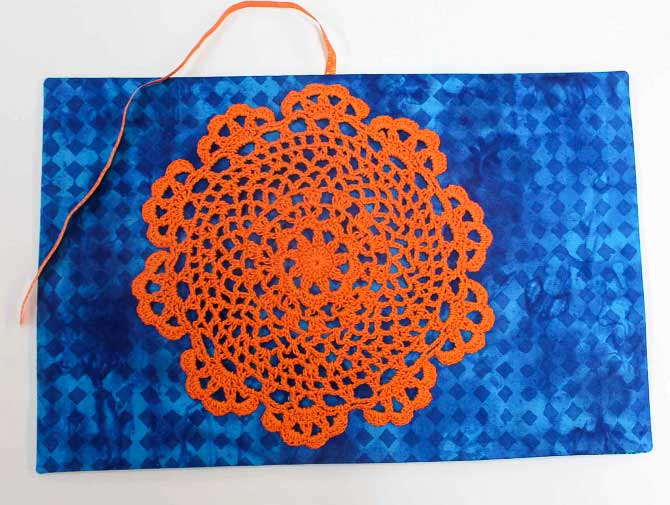 Crocheted doily used as journal cover.