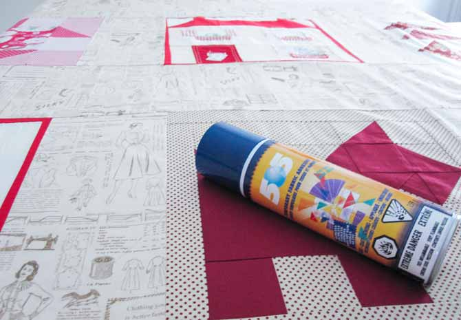 The quilt sandwich basted together with spray adhesive-- the better to free motion quilt the neutral spaces.