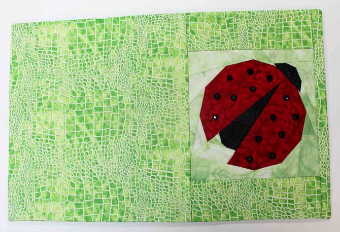 Another orphan block from Mary. Looks so cute as a journal cover. The orphan block is the lady bug - I found the other green in my stash.
