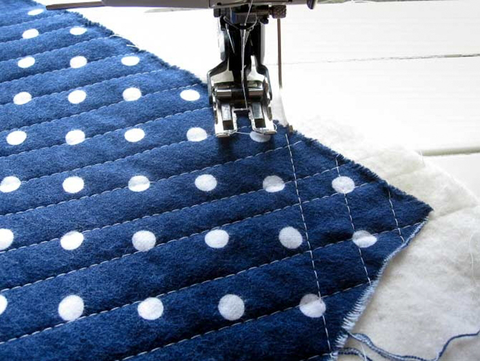 Create a diamond pattern by quilting a line of stitches diagonally in one direction and then the other.