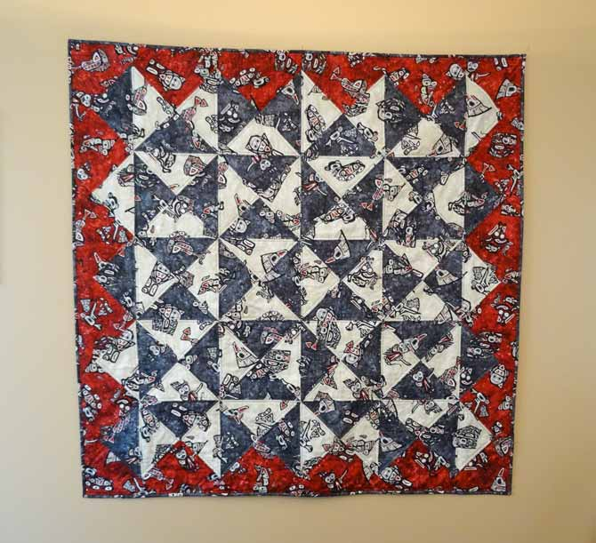 "The completed baby quilt, it measures 49"" x 49"""