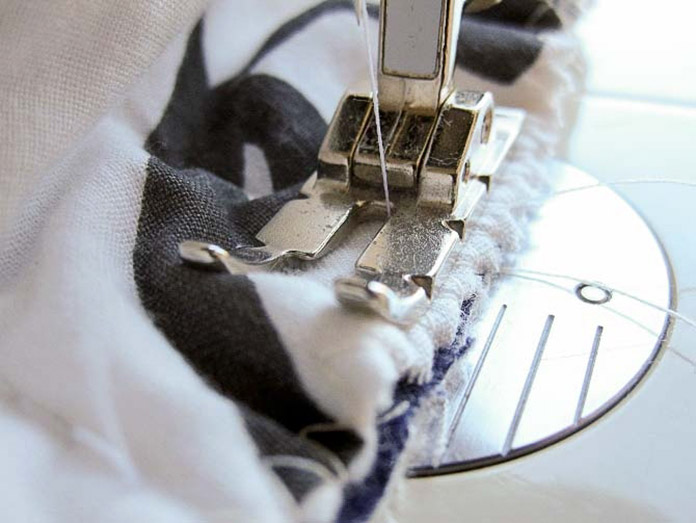 Sew the circle ends to the ends of the quilted main fabric.