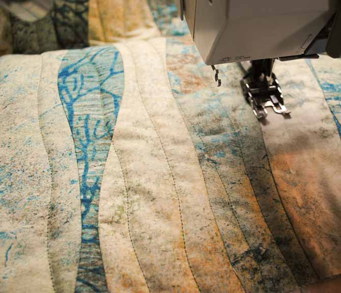 A walking foot was used to quilt wavy lines from the top to the bottom of the quilt