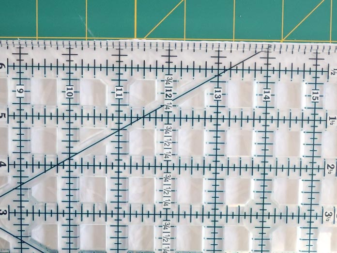 A piece of fabric cut without using a TrueCut My Perfect Rotary Cutter may cause a wave cut.