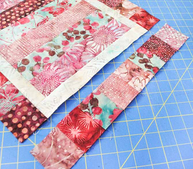 Sixteen squares are sewn together to make each of the long outer borders and eight squares are sewn together to make each of the end borders