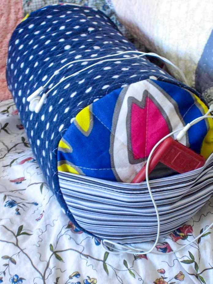 Soft and cozy pillow in quilted flannel. This study pillow holds music and chocolate.