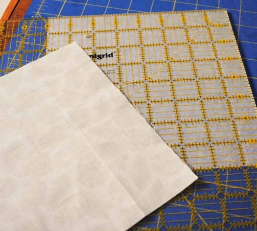 """Cut one 8"""" square of fabric and one 8"""" square of fusible interfacing"""
