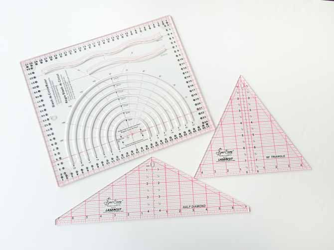 The KOMFORT KUT Slash-N-Circle Quilting Ruler, Sew Easy Triangle Ruler 60° and the Sew Easy Half Diamond Ruler