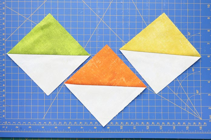 Half square triangle blocks made using Northcott Canvas fabrics.