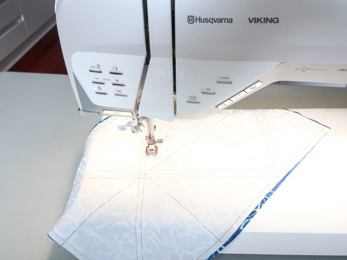 "Sew a seam ¼"" on each side of the diagonal line."