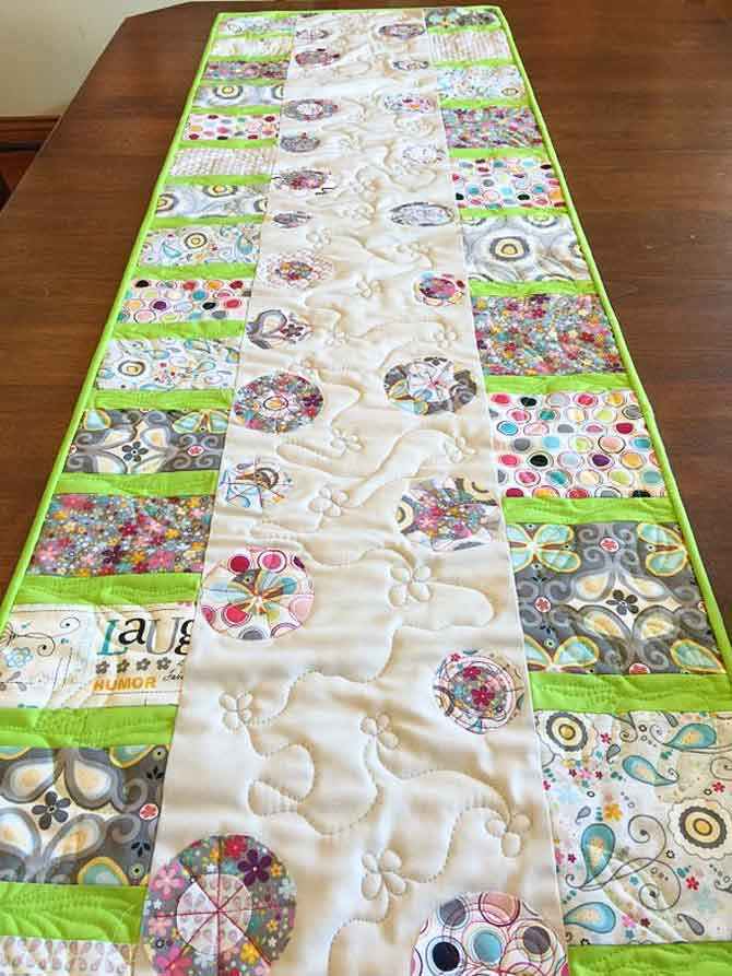 Modern table runner using fused circles to create flowers and piecing to make stems