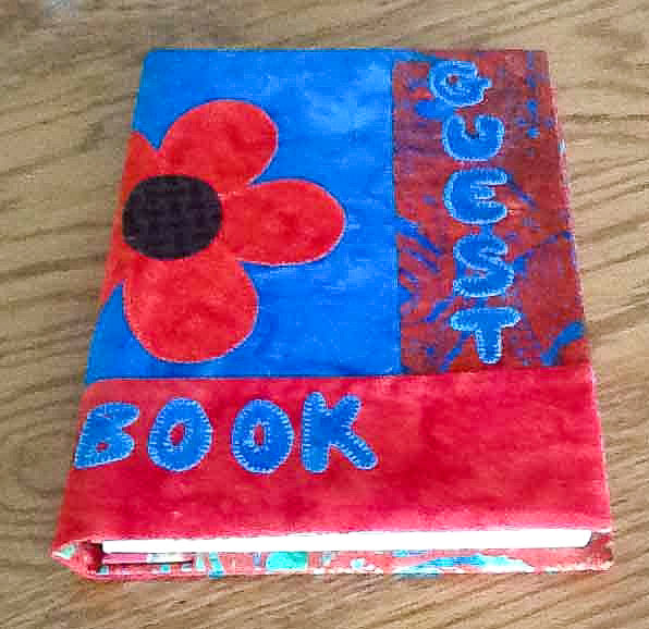 Fabric journal cover with flower applique.