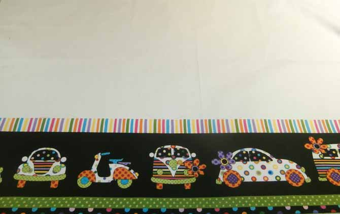 The fussy cut border print is stitched to the bottom of the pillow case base fabric. Northcott Urban Elementz.