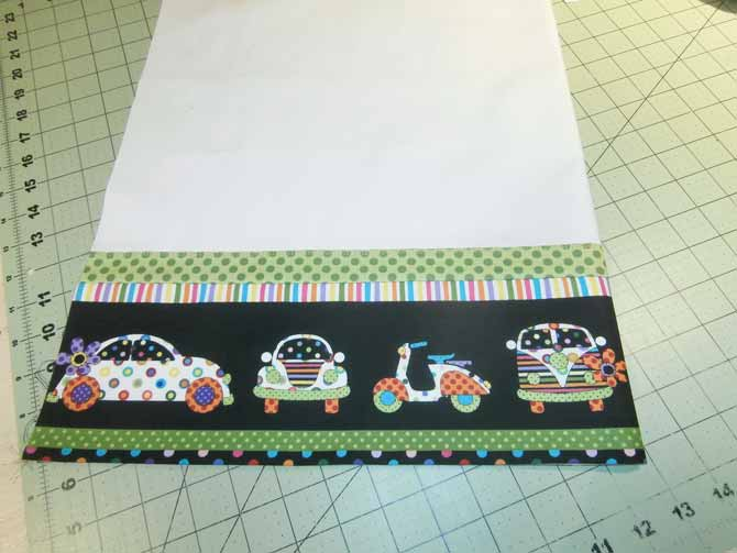 """With the border complete, the pillow case top panel is folded in half, wrong sides together with the 24½"""" edges aligned. Northcott Urban Elementz."""