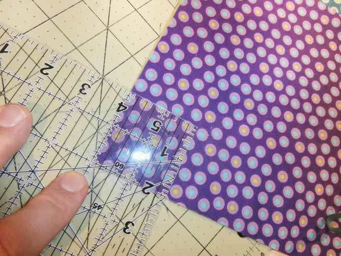 "Hint: An easy way to mark that 2"" square is to simply align the corner of your ruler with the 2"" marking aligned on the side and bottom of the fabric, and draw the square. Northcott."