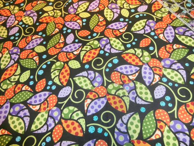 Overall leaf print fabric selected for the outer border of a landscape table runner. Northcott Urban Elementz.