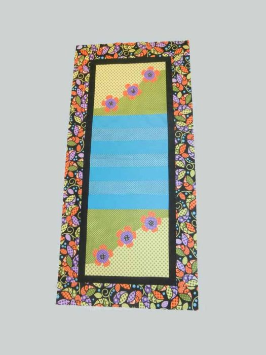Landscape table runner with a small black inner border, and a larger leaf outer border. Northcott Urban Elementz.