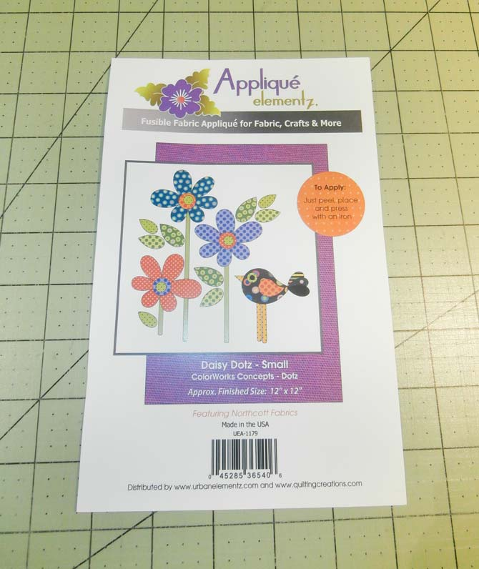 Daisy Dotz - Small package of fusible appliques featuring three flowers with stems and a bird. Northcott Urban Elementz Applique.