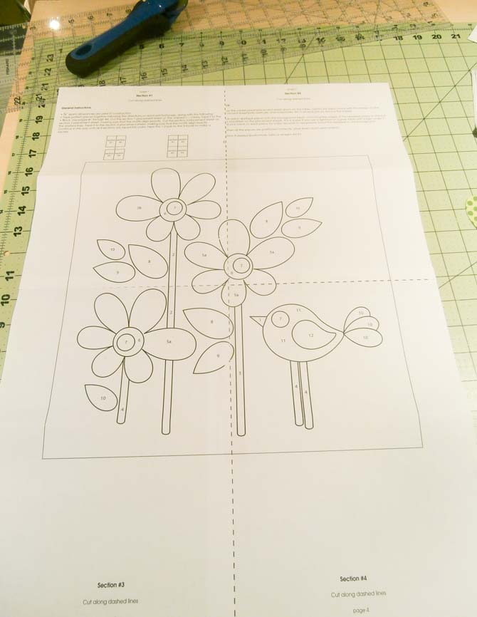 "Applique design sections are taped together to complete the 12"" applique design template"