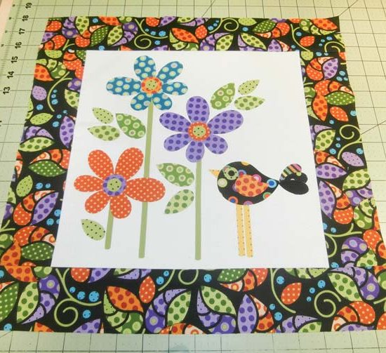 Appliqued cushion top with border added. Northcott Urban Elementz Applique.
