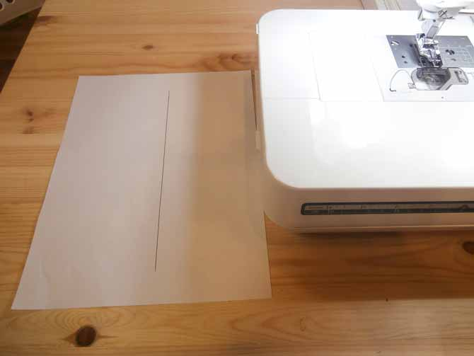 Draw a straight line in the center of a regular piece of printer paper