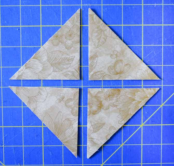 "Here is the 5"" square cut in half diagonally twice to make the large setting triangles"