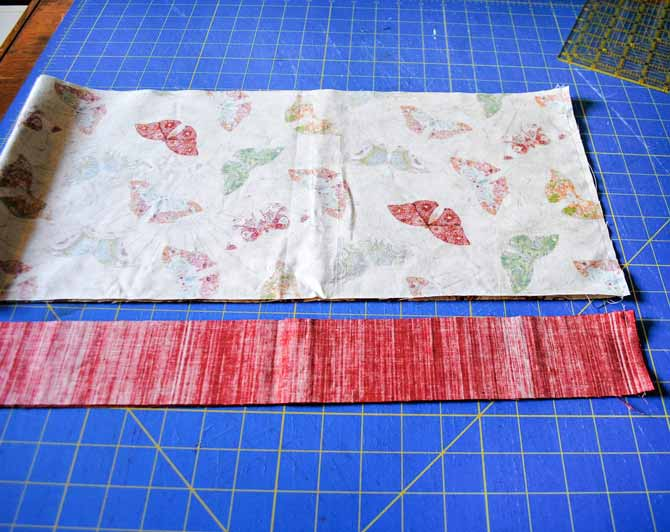 This photo shows the two strips of fabric that will be used for the pillowcase cuff and trim the cuff and trim strips folded in half and sewn at the ends.