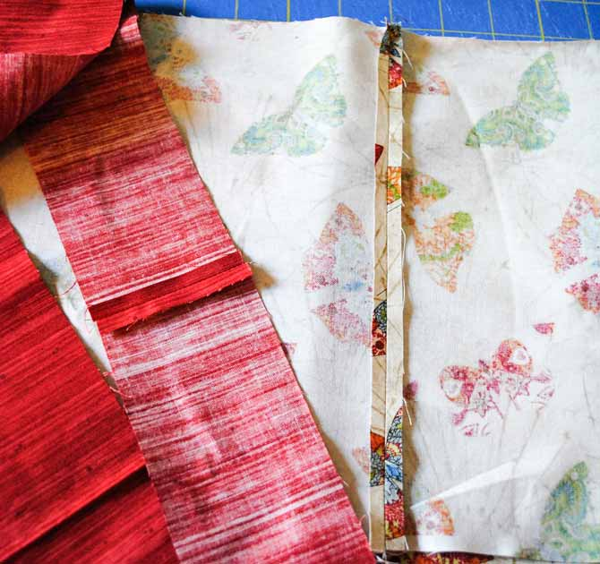 The seams of the cuff and the trim for the pillowcase are then pressed open.