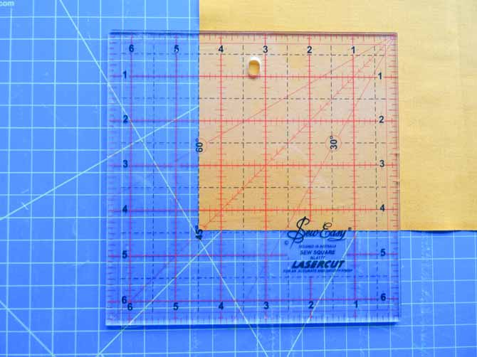 "Using the SEW EASY Square Ruler - 6½"" x 6½"" to cut fabric squares for our modern quilt."
