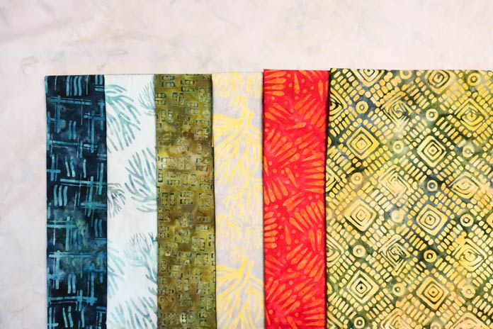 6 fabrics from the Nostalgic Vibes collection used to make this week's quilt.