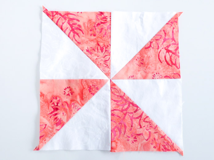 Sew 2 Half Square Triangle units together and repeat.