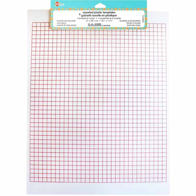A package of HEIRLOOM assorted plastic template sheets, contains six sheets, four with grid lines and two without.