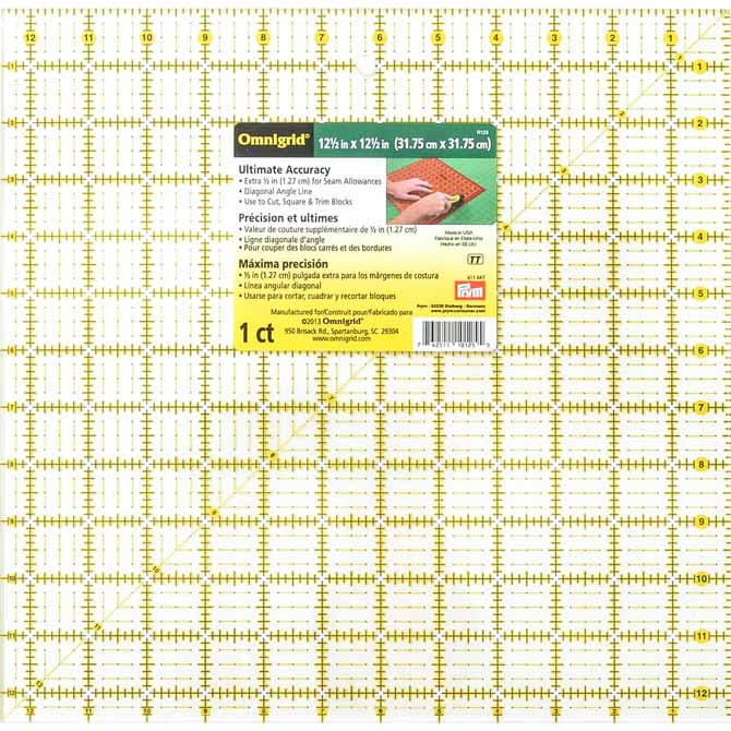 "A 12½"" x 12½"" OMNIGRID Ruler is great for cutting and squaring and can be used by both right and left handed sewers."