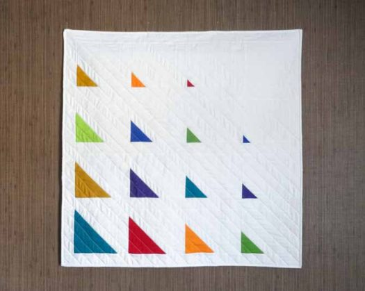 The modern half square triangle quilt is completed.